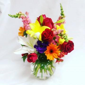 Surtido de colores en florero